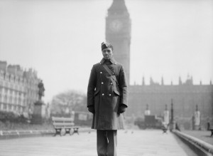 RAF_student_pilot_Jellicoe_Scoon,_a_West_Indian_from_Trinidad,_in_Parliament_Square_in_London,_26_March_1942._CH5213